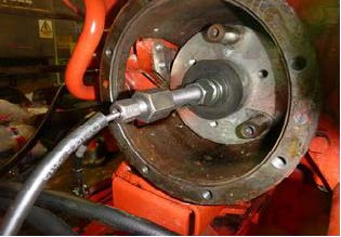 Coolant pump being hydraulically released