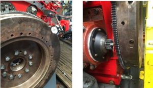 Flywheel fitted to engine and being tested.